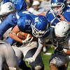 CARL RUSSO/Staff photo. Methuen's William Weinhold leaps head first over Dracut defenders for extra yardage. Methuen defeated Dracut in Saturday afternoon football action 35-20. 9/28/2013.