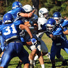 CARL RUSSO/Staff photo. Methuen defenders swarm all over Dracut's Dan O'Connell to make the tackle in first half action. Methuen defeated Dracut in Saturday afternoon football action 35-20. 9/28/2013.