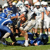 CARL RUSSO/Staff photo. Dracut's quarterback, Tyler Bassett gets sacked by  Methuen defenders from left, Joe Roy, Luis Sanchez and Nick Comeford  in the first half. Methuen defeated Dracut in Saturday afternoon football action 35-20. 9/28/2013.