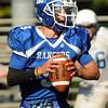 CARL RUSSO/Staff photo. Methuen's quarterback, Austin George-Williams looks to pass. Methuen defeated Dracut in Saturday afternoon football action 35-20. 9/28/2013.