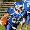 CARL RUSSO/Staff photo. Methuen's William Weinhold finds running room to make this 3rd. quarter touchdown. Methuen defeated Dracut in Saturday afternoon football action 35-20. 9/28/2013.