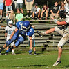 CARL RUSSO/Staff photo. Methuen's Evan Lacroix leaps into the air as he makes a good but unsuccessful attempt to block Dracut's punt. Methuen defeated Dracut in Saturday afternoon football action 35-20. 9/28/2013.