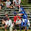 CARL RUSSO/Staff photo. Methuen's Brian Cole catches this 57-yard touchdown pass down the sideline seconds before half-time to give Methuen the 22-14 lead. Methuen defeated Dracut in Saturday afternoon football action 35-20. 9/28/2013.