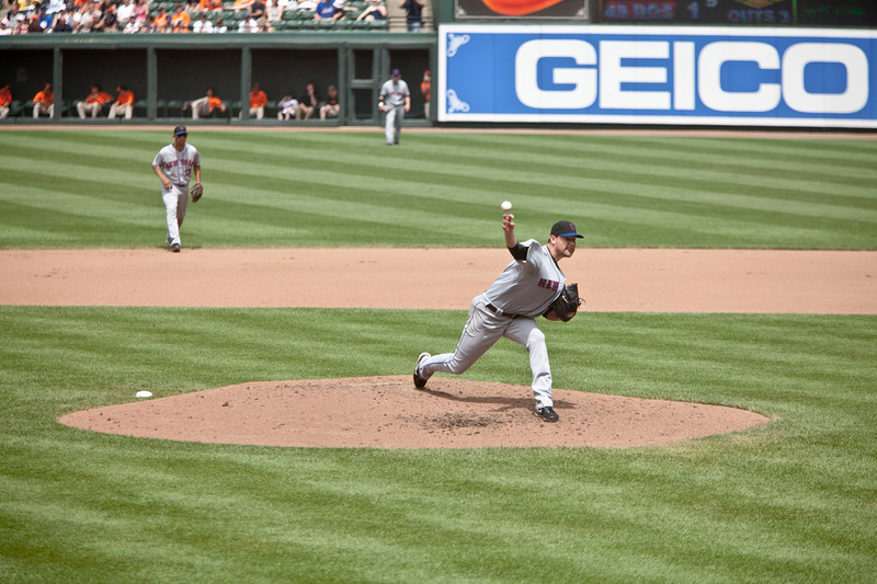 NY Met Mike Pelfrey pitching against the Baltimore Orioles at Camden Yards on June 13, 2010. Also seen is the right side of the defense.