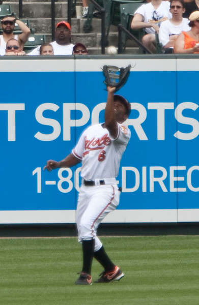 Baltimore Oriole left fielder Corey Patterson catching a fly ball against the NY Mets at Camden Yards on June 23, 2010.