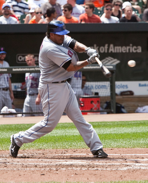 A tight shot of NY Met DH Fernando Tattis (AL park rules) hitting against the Baltimore Orioles at Camden Yards on June 13, 2010.