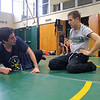 Michael Dube, 15, of Lancaster will be wrestling for Nashoba Regional High School this winter. Here he listens to alumni Joel Sharin during Monday's practice at the school. SENTINEL & ENTERPRISE/JOHN lOVE