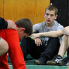 Michael Dube, 15, of Lancaster will be wrestling for Nashoba Regional High School this winter. During practice on Monday he listens to his coach as he shows the next moves they wouldl be trying. SENTINEL & ENTERPRISE/JOHN LOVE