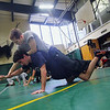 Michael Dube, 15, of Lancaster will be wrestling for Nashoba Regional High School this winter. Here he wrestles with alumni Joel Sharin during Monday's practice at the school. SENTINEL & ENTERPRISE/JOHN lOVE
