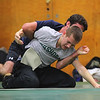 Michael Dube, 15, of Lancaster will be wrestling for Nashoba Regional High School this winter. Here he wrestles with alumni Joel Sharin during Monday's practice at the school. SENTINEL & ENTERPRISE/JOHN lOVE
