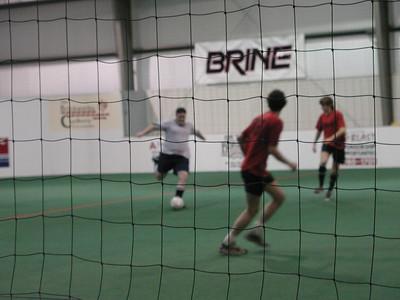 Action shot of Sam kicking the ball.