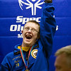 Record-Eagle/Jan-Michael Stump<br /> Trevor Taylor celebrates his gold medal following the Special Olympics Michigan State Winter Games speed skating finals Thursday at Howe Arena.