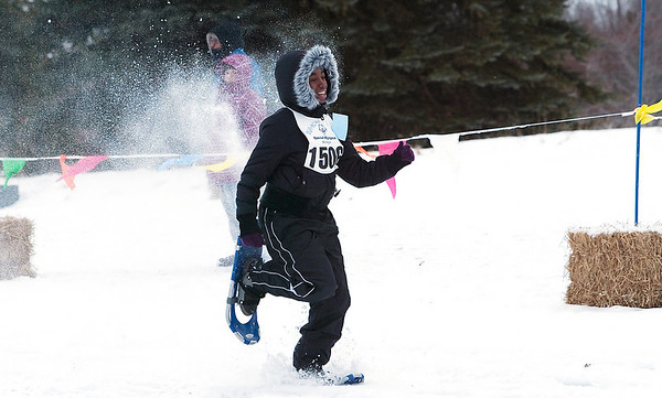 Record-Eagle/Douglas Tesner<br /> Waynika Stewart heads toward the finish line in the semifinals of the snowshoe races.