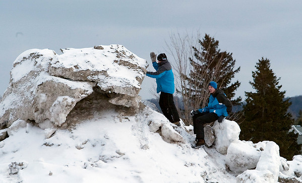 Record-Eagle/Douglas Tesner<br /> Stephen Llyod and Nathan Raney climb a pile of ice and snow as the wait the arrival of Wertz Warriors.