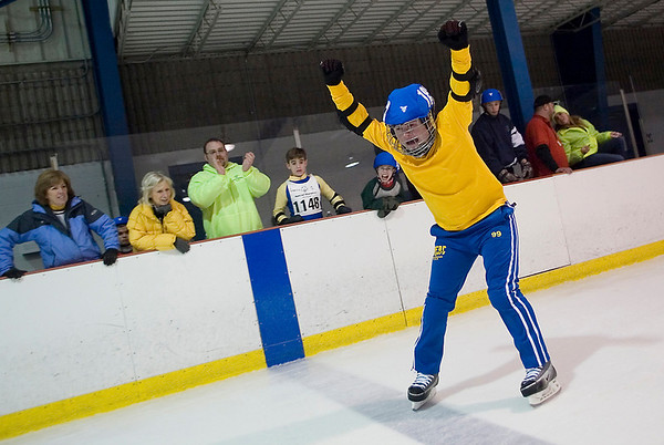 Record-Eagle/Jan-Michael Stump<br /> Anthony Kuckarski celebrates winning his heat in the 300 meters during Thursday's Special Olympics speed skating finals at Howe Arena.