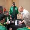 Record-Eagle/Douglas Tesner<br /> Wertz Warriors sign autographs for Scott Leutz, a participant in the 2010 State Winter Games Special Olympics before opening ceremonies.