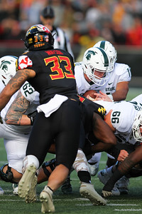 Michigan State quarterback #14 Brian Lewerke dives for a first down on a QB keep