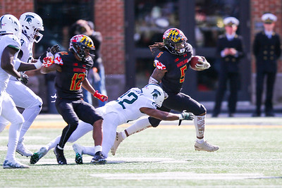 Maryland RB #5 Anthony McFarland breaks a tackle by Michigan State CB #22 Josiah Scott
