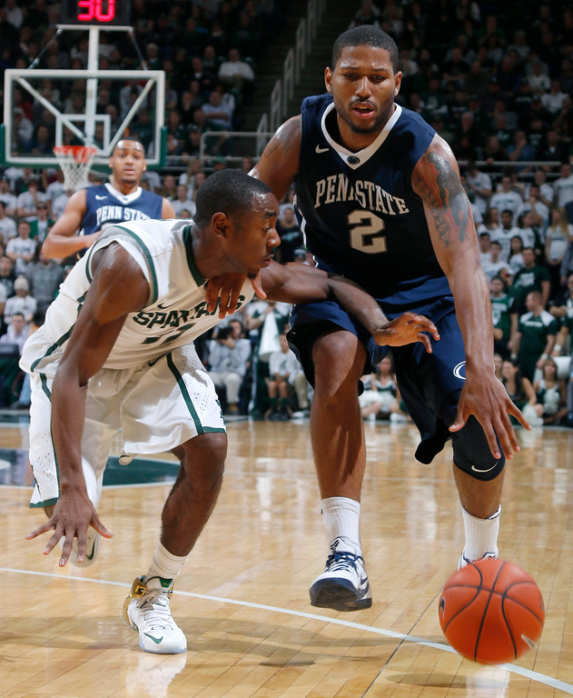 . Penn State\'s D.J. Newbill (2) is fouled on a drive by Michigan State\'s Lourawls Nairn Jr. during the second half of an NCAA college basketball game, Wednesday, Jan. 21, 2015, in East Lansing, Mich. Newbill led all scorers with 27 points. Michigan State won 66-60. (AP Photo/Al Goldis)