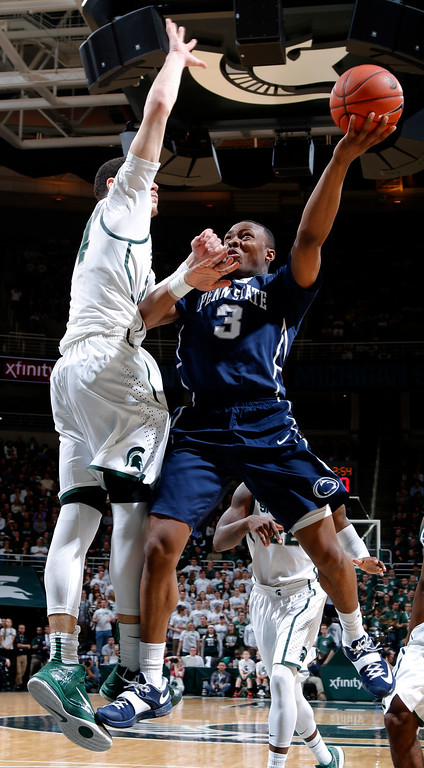 . Penn State\'s Devin Foster (3) goes to the basket against Michigan State\'s Gavin Schilling during the first half of an NCAA college basketball game, Wednesday, Jan. 21, 2015, in East Lansing, Mich. (AP Photo/Al Goldis)