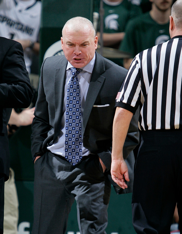 . Penn State coach Patrick Chambers yells at an official before being charged with a technical foul during the second half of his team\'s NCAA college basketball game against Michigan State, Wednesday, Jan. 21, 2015, in East Lansing, Mich. Michigan State won 66-60. (AP Photo/Al Goldis)