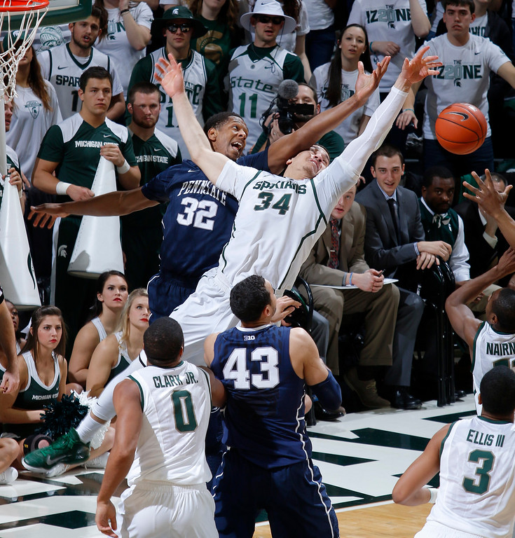 . Michigan State\'s Gavin Schilling (34) and Penn State\'s Jordan Dickerson (32) try for a rebound during the first half of an NCAA college basketball game, Wednesday, Jan. 21, 2015, in East Lansing, Mich. Watching are Michigan State\'s Marvin Clark Jr. (0) and Penn State\'s Ross Travis (43) (AP Photo/Al Goldis)