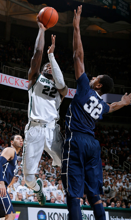 . Michigan State\'s Branden Dawson (22) shoots against Penn State\'s Jordan Dickerson (32) during the second half of an NCAA college basketball game, Wednesday, Jan. 21, 2015, in East Lansing, Mich. Dawson led Michigan State with 12 points and 10 rebounds in a 66-60 win. (AP Photo/Al Goldis)