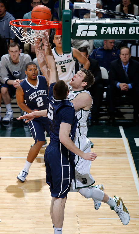 . Michigan State\'s Matt Costello, right, shoots a layup against Penn State\'s Donovan Jack (5) during the first half of an NCAA college basketball game, Wednesday, Jan. 21, 2015, in East Lansing, Mich. Michigan State won 66-60. (AP Photo/Al Goldis)