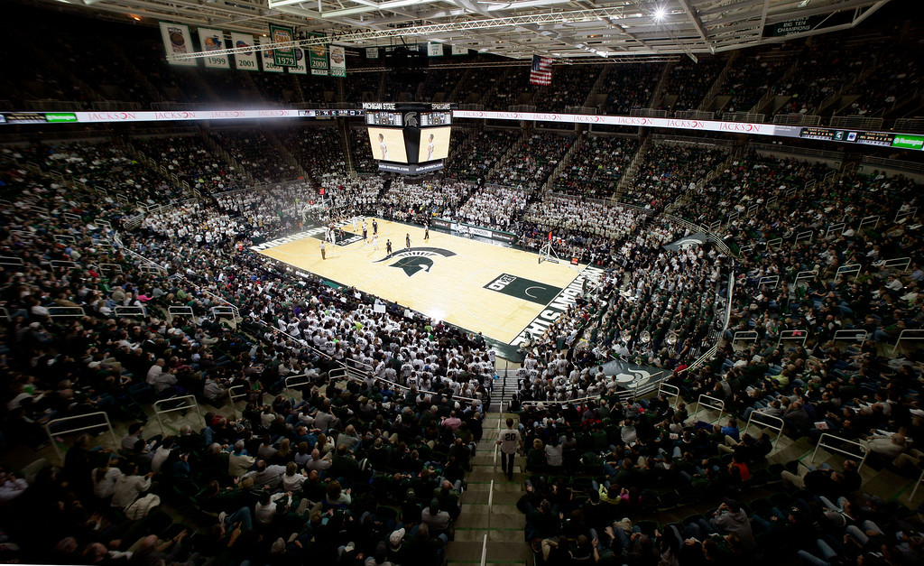 . Michigan State and Penn State play during the first half of an NCAA college basketball game, Wednesday, Jan. 21, 2015, in East Lansing, Mich. The game was the 400th at the Breslin Center. Michigan State won 66-60. (AP Photo/Al Goldis)