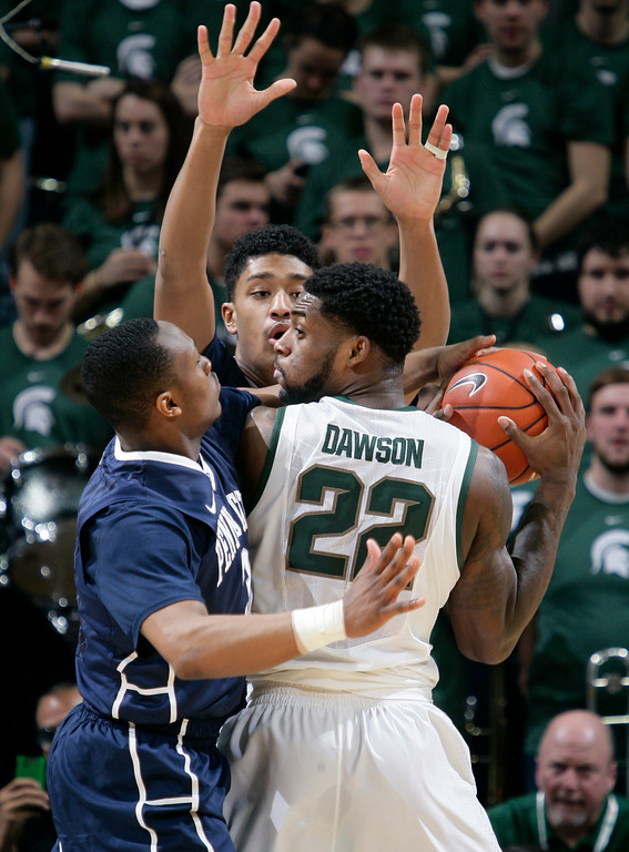 . Michigan State\'s Branden Dawson (22) is pressured by Penn State\'s Devin Foster, left, and Julian Moore during the first half of an NCAA college basketball game, Wednesday, Jan. 21, 2015, in East Lansing, Mich. Michigan State won 66-60. (AP Photo/Al Goldis)