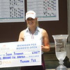 Sarah Burnham poses with the Michigan PGA Women's Open championship trophy.