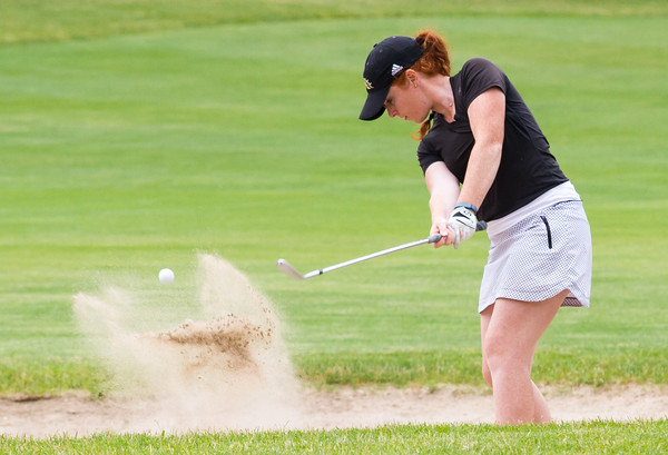 Record-Eagle/Brett A. Sommers Frankenmuth's Kaitlyn Watkins hits from the bunker on No. 10 at Crystal Mountain Monday during the 23rd Women's Michigan Open.