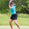 Record-Eagle/Brett A. Sommers East Lansing's Mackenzie Johnson hits from the tee box during Monday's Michigan Women's Open.