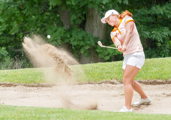 Record-Eagle/Brett A. Sommers Brighton's Hannah Pietila hits from the bunker on No. 13 at Crystal Mountain on Monday during the 23rd Women's Michigan Open.