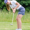 Record-Eagle/Brett A. Sommers Traverse City West graduate Taylor Kehoe putts on No. 10 at Crystal Mountain Monday during the 23rd Women's Michigan Open. Kehoe shot an opening round 13-over 85.