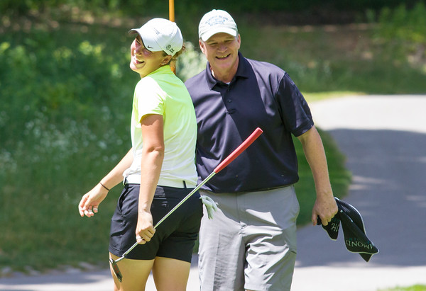 Record-Eagle/Brett A. Sommers Central Michigan graduate assistant Lauren Grogan and her father, Dennis, celebrate Grogan's seventh birdie of the day on No. 18 at Crystal Mountain during the 23rd Michigan Women's Open. Grogan shot an opening round best 7-under 65.