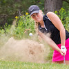 Record-Eagle/Brett A. Sommers Dayton University's Emma Meyer hits from the bunker on No. 10 at Crystal Mountain Monday during the 23rd Women's Michigan Open.