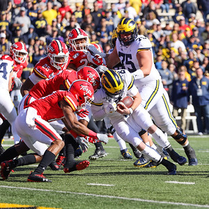 Michigan QB Shea Patterson is stopped short of the goal line by the Terps defense.