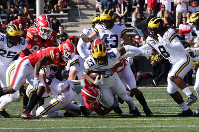 Michigan LB Michael Barrett carries the ball for a first down on a fake punt.