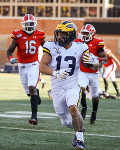 Michigan RB Tru Wilson accelerates away from Maryland defenders.