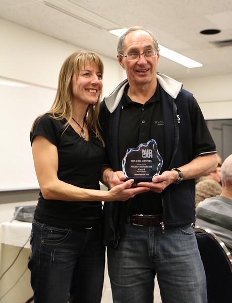Bob Groff being awarded the Mickey Stockotelny Award by Lynda Thompson