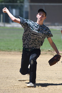 KRISTIN BAUER   CHRONICLE  Columbia High School pitcher Charlie Simon (23) pitches against Keystone on Sunday afternoon, July 10.
