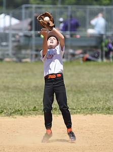 KRISTIN BAUER   CHRONICLE  Buckeye shortstop Cody Burgess (22) pitches against Keystone on Sunday, July 10.