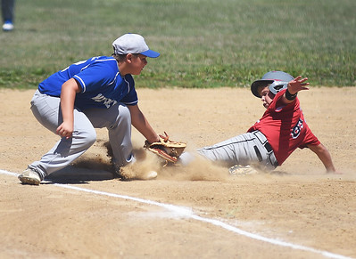 KRISTIN BAUER   CHRONICLE  Midview High School third baseman Blake Cogswell (12) lays down the tag, but South Amherst's Aidan Neman (6) beats it, and is safe at third.