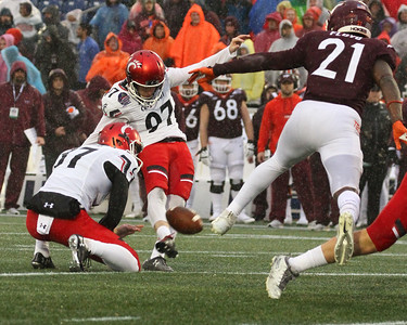 Cincinnati kicker #97 Ryan Jones kicks an extra point