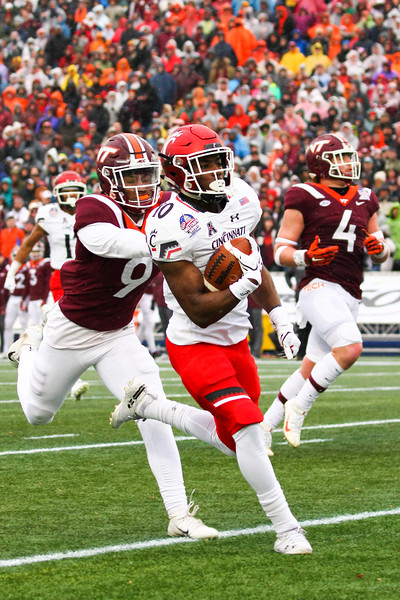 Cincinnati running back #10 Charles McClelland evades Virginia Tech #9 Khalil Ladler.
