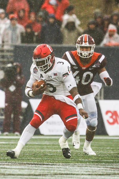 Cincinnati running back #3 Michael Warren II evades Virginia Tech defensive end #40 Emmanuel Belmar