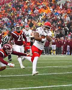 Cincinnati running back #10 Charles McClelland evades a Virginia Tech defender.