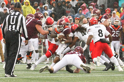 Virgina Tech runningback #32 Steven Peoples fights through Cincinnati defensive players