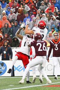 Cincinnati #1 Khalil Lewis, #12 Alec Pierce and Virginia Tech #26 Jovonn Quillen battle for control of a punted ball.